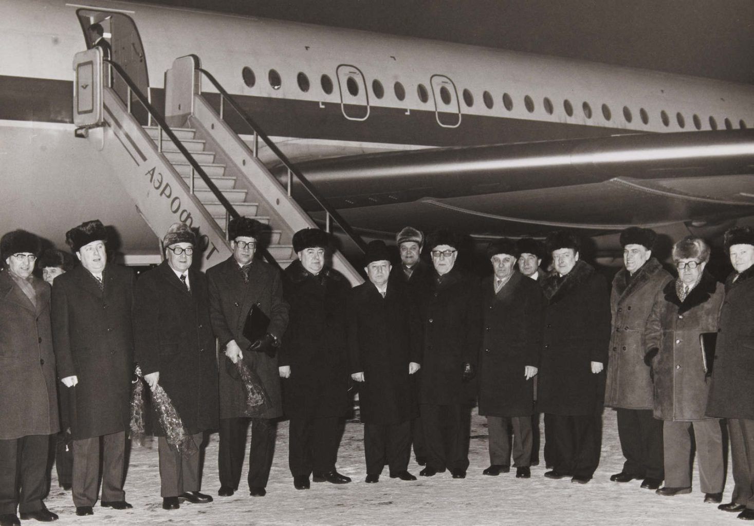 "Unique photograph of the visit of the leaders of STASI of the GDR (General Erich MIELKE, General Markus WOLF, etc.) to Moscow (USSR) during the winter of 1980. None of the Western secret services had succeeded in photographing Markus WOLF (known as ""the man without a face""), head of HV A (STASI's external intelligence) during the Cold War period, which makes this photo ""unique"". The photo was taken at the foot of an Aeroflot plane and shows 3 successive KGB presidents (5th left: Vitaly FEDORCHUK (president in 1988), 8th left: Viktor CHEBRIKOV (president from 1982 to 1988), and far right: Vladimir KRYUCHKOV (president from 1988 to 1991)), in the presence of STASI Generals Markus WOLF (4th left) and Erich MIELKE (6th left)."