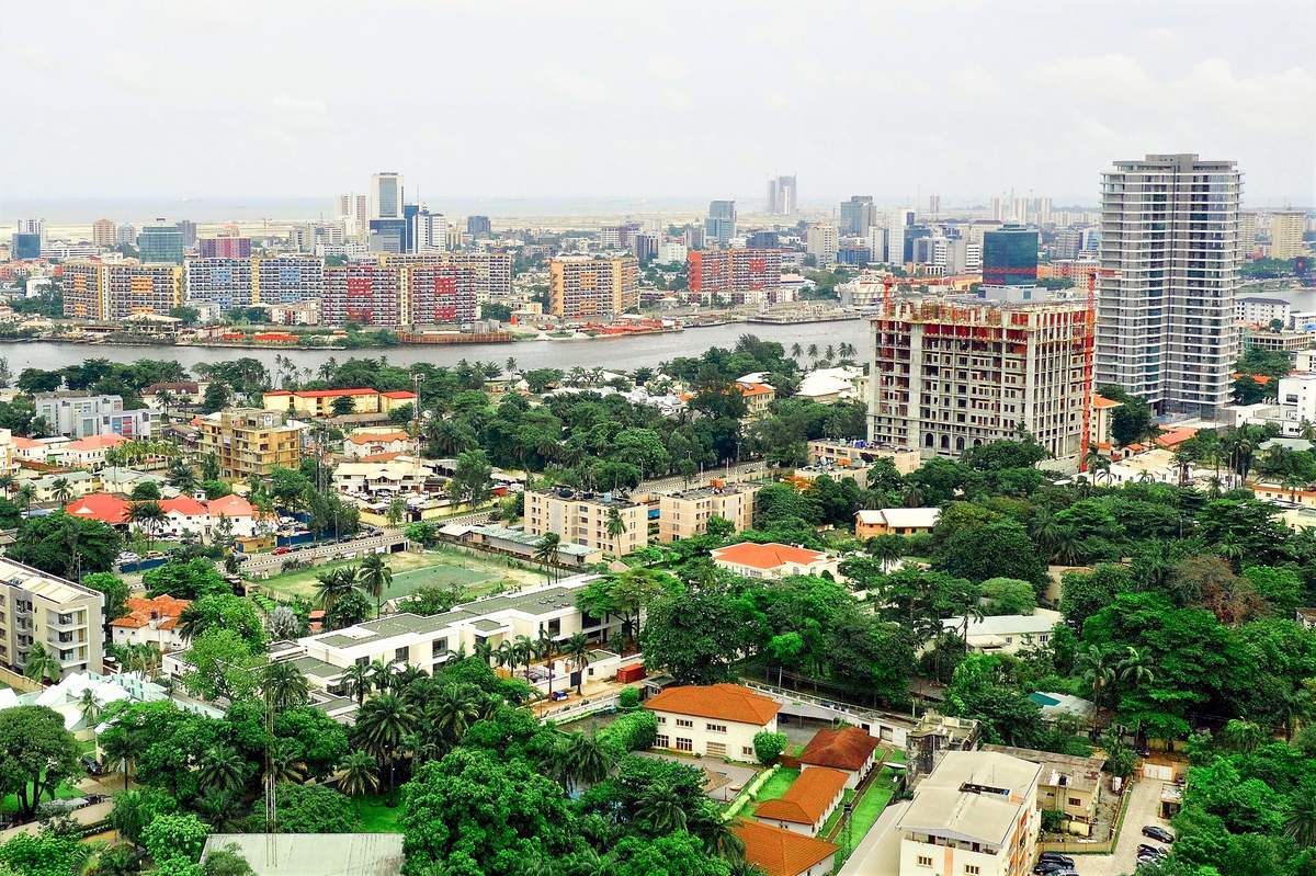 Ikoyi, an upscale suburb of the megacity Lagos, Nigeria. Beyond the lagoon is Victoria Island, and beyond that is the new city under construction called Eko Atlantic City, right on the Atlantic Ocean.- Reginald Bassey, CC BY-SA 4.0, via Wikimedia Commons